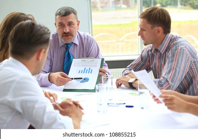 Business meeting - manager discussing work with his colleagues