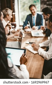 Business Meeting Of Multi-Ethnic Office Workers, Selective Focus On Caucasian Business Woman Holding Pan, Coworkers Team Have Brainstorming In Board Room, Toned Image