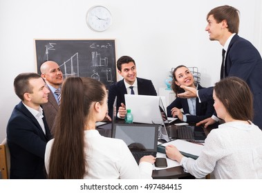 Business meeting of multinational managing team in office
