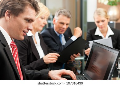 Business - meeting in an office, the businesspeople are discussing a project