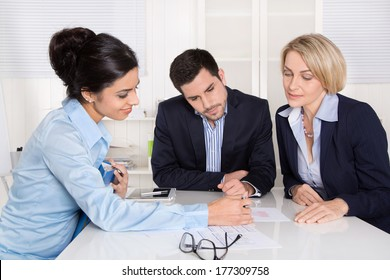 Business meeting at office with three business people.
