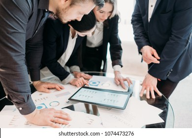 business meeting. problem solving, issue management. troubleshooting. communication, information exchange. executives discussing company results reading papers with graphical data