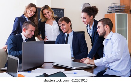 Business meeting of successful team at office interior