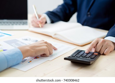 Business meeting time. Photo young account managers crew working with new startup project. Notebook on wood table. Idea presentation, analyze plans.business concept.
