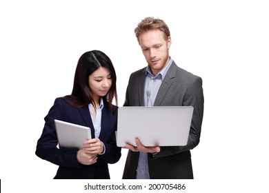 Business meeting - two managers discussing on tablet computer isolated on white background