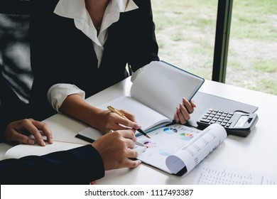 business meeting, business woman Explain analyze the company's sales plan and business owner by use calculator for financial documents