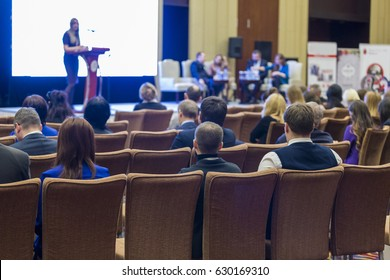 Business Meetings Ideas and Concepts. Many People at the Law Conference Listening to The Female Host on Stage.Horizontal Image