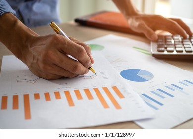 Business men looking at charts, spreadsheets, graph financial development, bank accounts, statistics, economy, data analysis, investment analysis, stock exchange