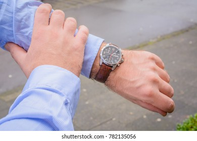 Business men looking at watch
