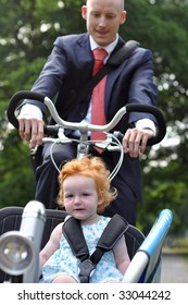 Business men riding his young child to the baby creche