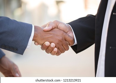 Business men shaking hands.