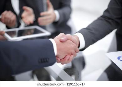 Business men shaking hands. Closeup.