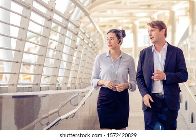 Business men talk to business women While walking and resting on the Skywalk, Teamwork, partnership concep