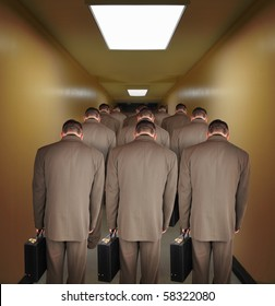 Business men are walking down a hallway to do office work. The heads are down to symbolize pressure or powerlessness from the job. Use it for an unemployment or a career concept.