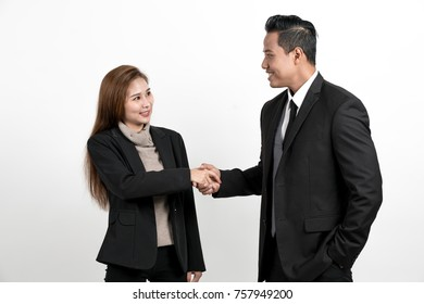 Business men and women agree in contract on white background