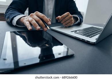 Business men work, on the desk laptop tablet, business