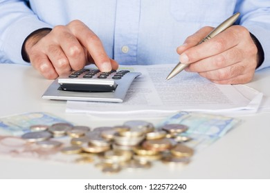 Business men working with documents and calculator  in the office
