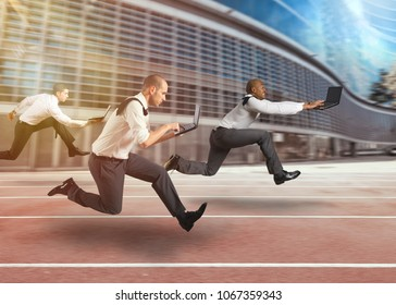 Business men working at full speed in a race track