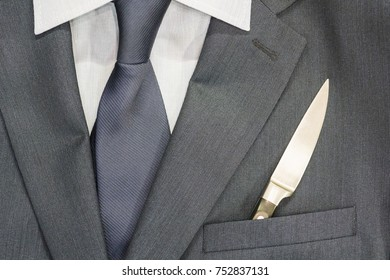Business men's suit. In the pocket lies a knife. It's lunch time. Sharp mind. The symbol of fast solutions.