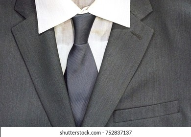 Business men's suit with a pocket and tie. A symbol of success.