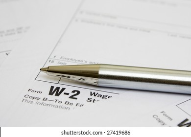 Business metal pen  on W-2 tax form