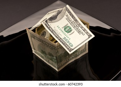 business metaphor - house of dollars in the plate