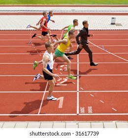 Business metaphore of staying ahead, winning in business,business competition, and continuous improvement, represented by a photo finish of a track race