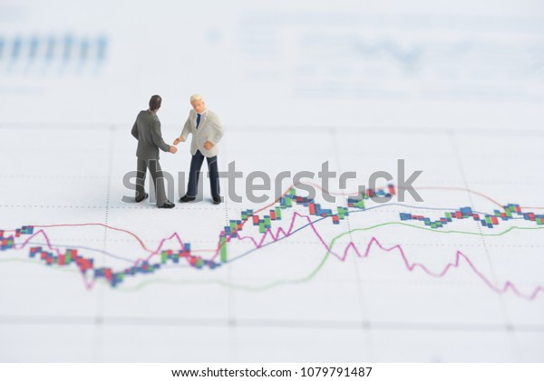 business miniature people on business graph