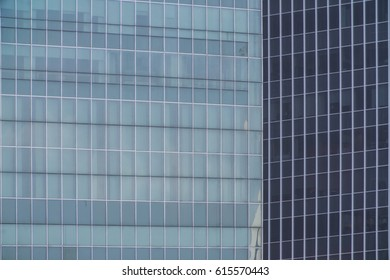 Business Modern architecture close up, texture windows of a high rise building