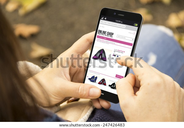 business and modern lifestyle concept: young woman shopping online at the park