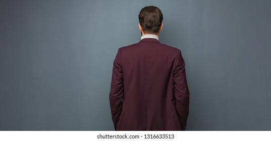 Business modern man from behind, looking back