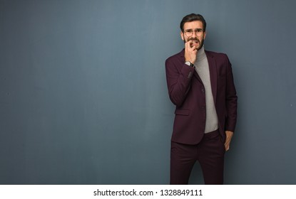 Business modern man biting nails, nervous and very anxious