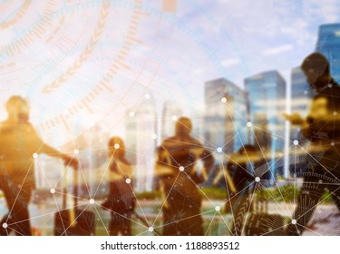 Business and modern technology concept. Double exposure of silhouetted people in city with wireless connection icons. Global communication.