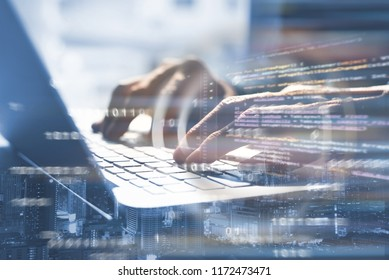 Business and modern technology, double exposure, man programmer coding on laptop computer and smart city with html code, binary on virtual screen, digital software technology development, IoT concept