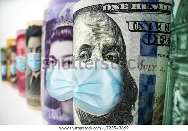 Business and money in covid 19 crisis - International money wearing face mask effected by covid 19 outbreak in concept of money saving and money investment under covid 19 situation.