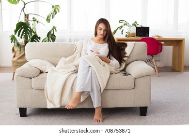 Business morning. Attractive brunette woman doing paperwork at home. Girl writing a letter to chief