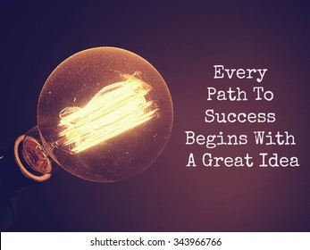 Business motivational quote of Every Path To Success Begins With A Great Idea ,on dark background with retro light bulb is glowing. Message for your design or inspirational poster.