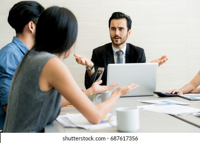 Business negotiation, male partners arguing, funny easygoing woman keeping calm in stressing situation, meditating with composed smile, dealing with emotional angry customer, stress management