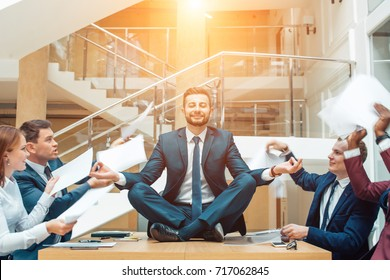 Business negotiation, male partners arguing, funny easygoing man keeping calm in stressing situation, meditating with composed smile, dealing with emotional angry customer, stress management concept