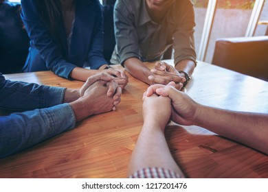 Business negotiation skills with the new generation of businesspeople sit at the conference table comfortably and hands crossed, body language for determination and willpower