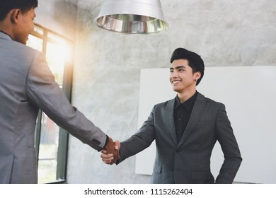 Business negotiation,Image of asian businessmen Handshaking,happy with work,Handshake Gesturing People Connection Deal Concept.