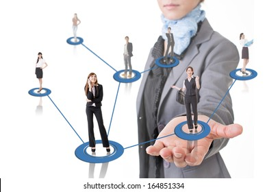 Business network conception, Asian business people use mobile phone to communicate to each other at a woman's hand.