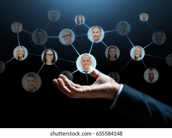 business, network, corporate and people concept - close up of businessman hand with contacts icons over dark background