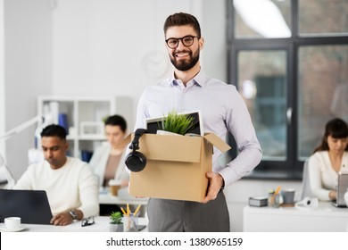 business, new job and quit concept - happy smiling male office worker with personal stuff