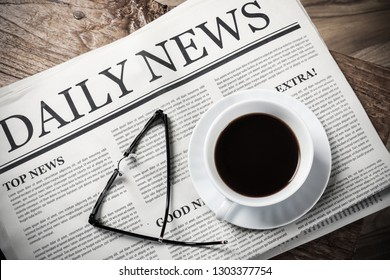 Business Newspaper on wooden desk with glasses and coffee cup, Daily Newspaper mock-up concept