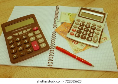 Business Objects in the office on the table, calculator and dollars on table. Money and a calculator on the table - Retro color