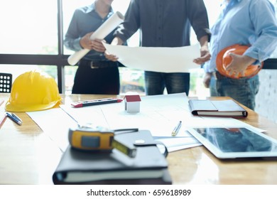 Business objects team engineers office construction stock photo business objects on background of team engineers discussing blueprint at meeting tool and safety helmet malvernweather Image collections