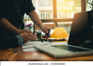 Business objects of team engineers office with construction engineer architect and worker looking building model(Meeting Team concept)