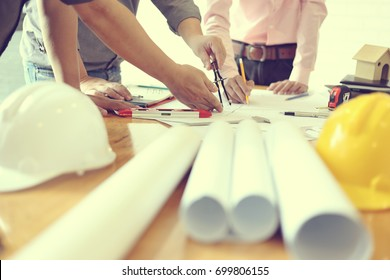 Business objects of team engineers office with construction engineer architect and worker looking building model  Team architect meeting concept