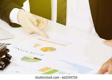business, office, accounting concept - businessman working in office, looking at statistics close up.